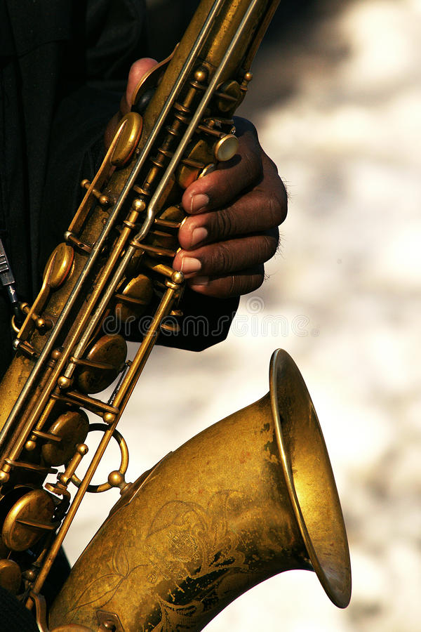 Saxophone. Black man playing saxophone in Central Park , uptown Manhattan, New york city royalty free stock photo