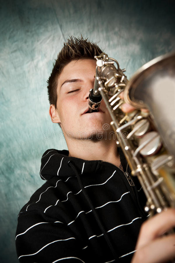 Download Saxophone stock photo. Image of jeans, handsome, musician - 29023692