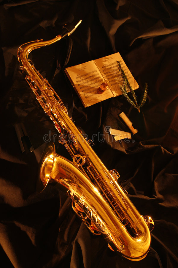 Saxophone. Tenor saxophone in candles light royalty free stock photo