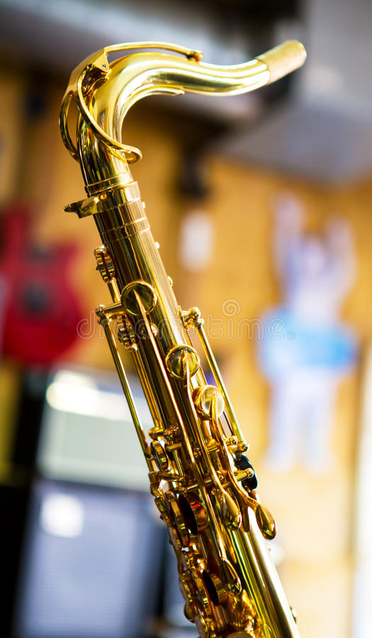 Saxophone. Closeup with golden keys over a colorful blurred background stock images