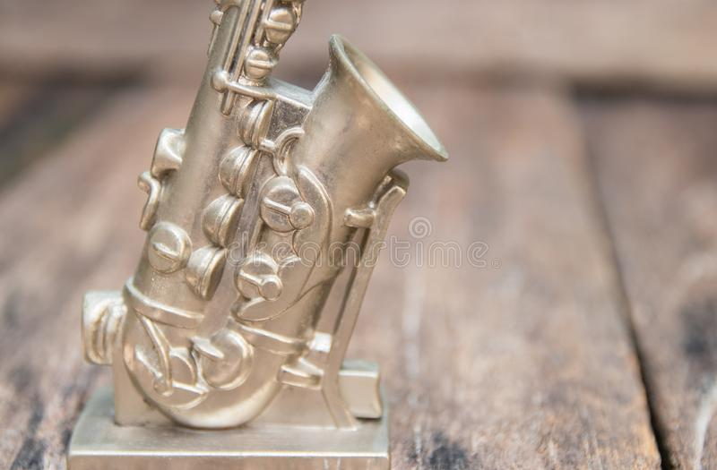 Saxophone for decorate old close up on vintage wooden background with copy space add text stock image