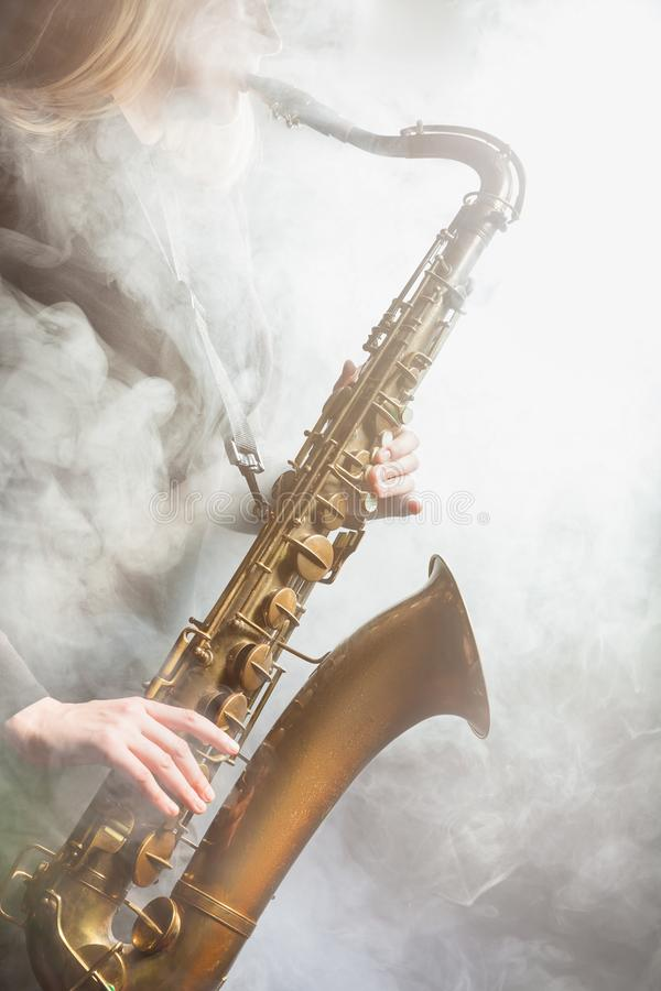 Saxophone in the fog royalty free stock image