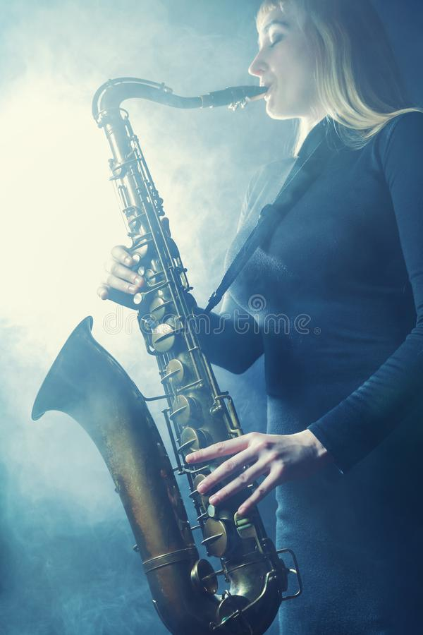 Saxophone in the fog stock images