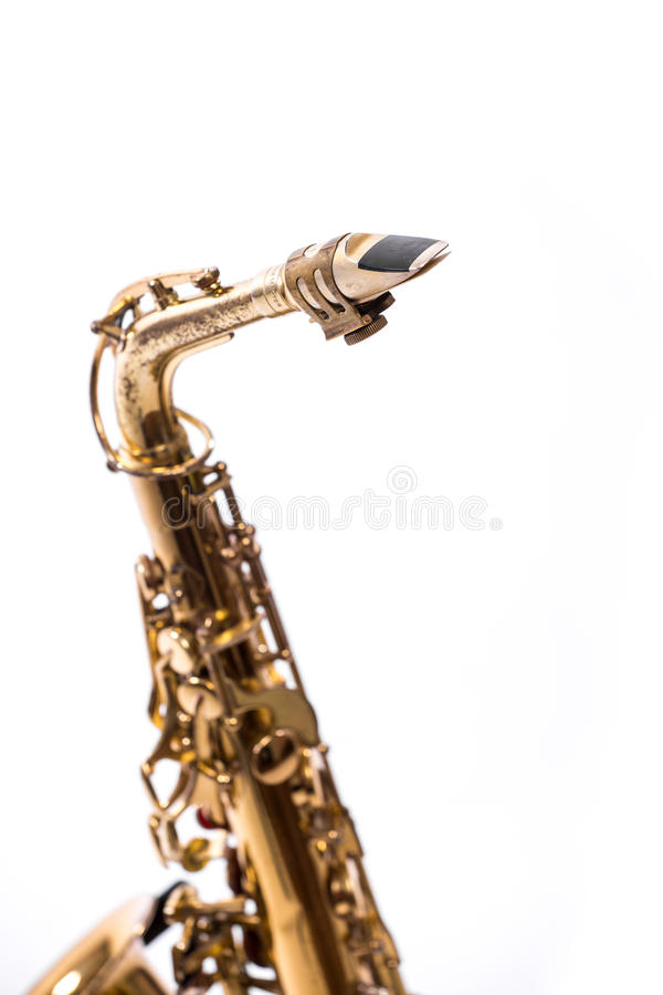 Saxophone. Golden alto  classical instrument isolated on white stock photo