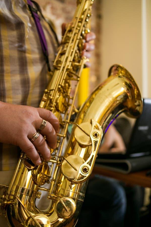 Saxophone jazz music instrument Tenor sax saxophonist hands Closeup player stock photo