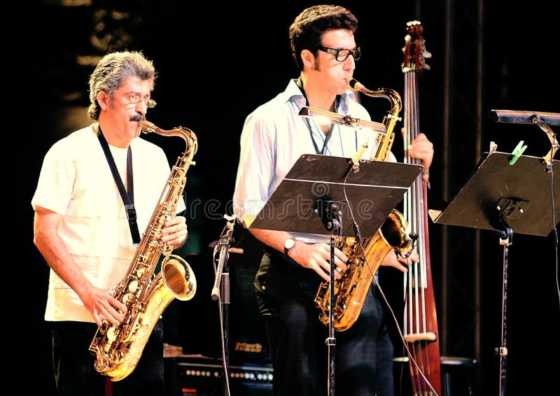 Saxophone men , jazz. Egyptian local jazz musicians playing saxophone with their band in a jazz concert at a theater at salahadin citadel in cairo in egypt on