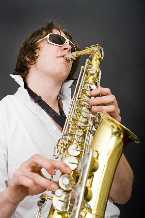 Download Saxophone player stock photo. Image of white, strap, single - 13256496