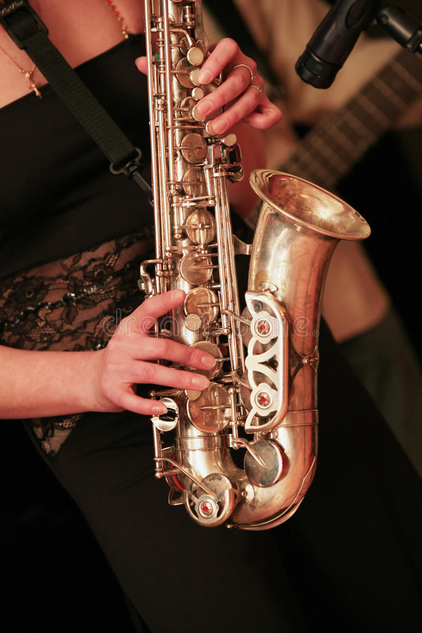 Saxophone player. On dark background royalty free stock images