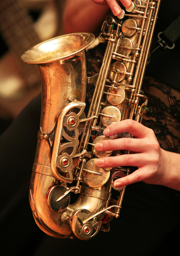 Saxophone player. On dark background stock image