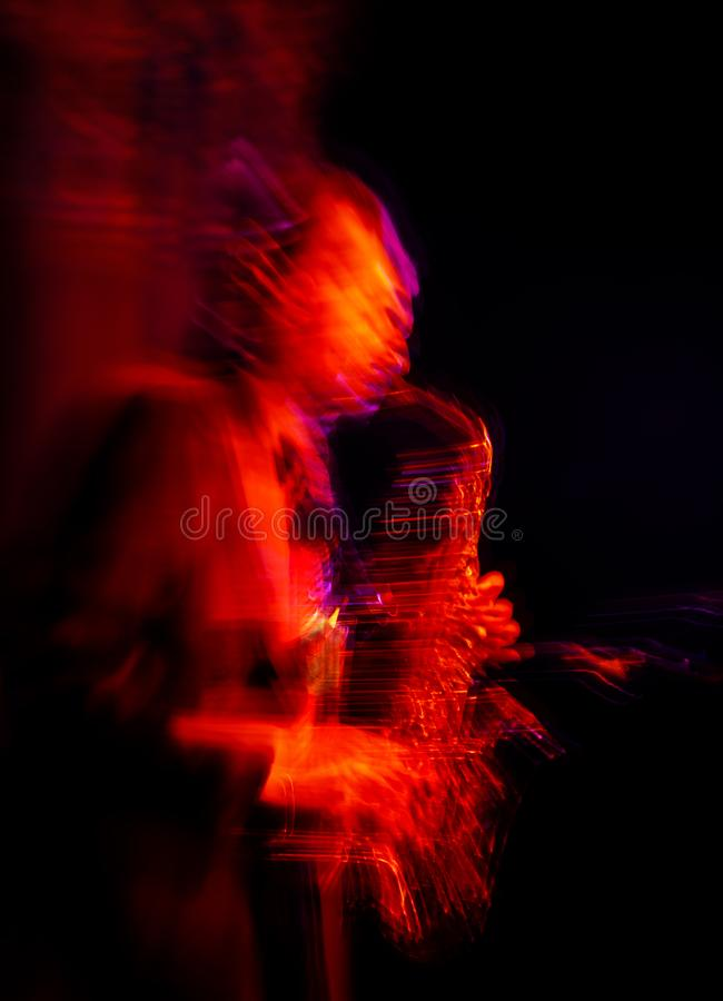 Saxophone player performing on stage stock photos