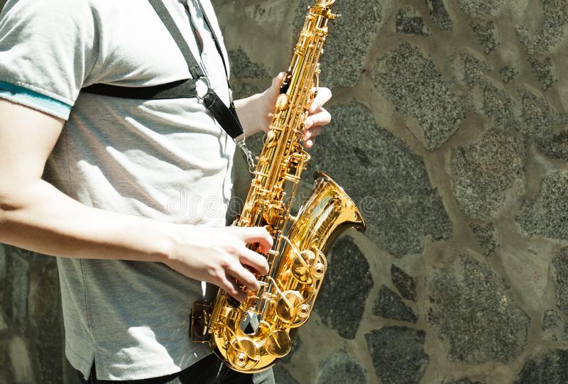 Saxophone player Saxophonist. Playing jazz music instrument Jazz musician playing sax alto royalty free stock images