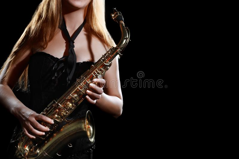 Saxophone player. Saxophonist woman with sax. Saxophone player. Saxophonist woman sax player with musical instrument jazz musician stock photo