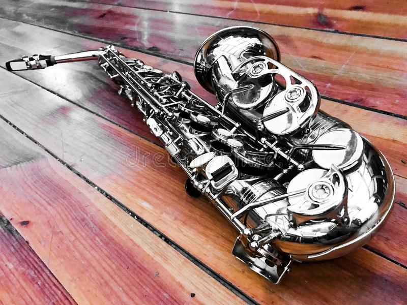 Saxophone. On wood stock images