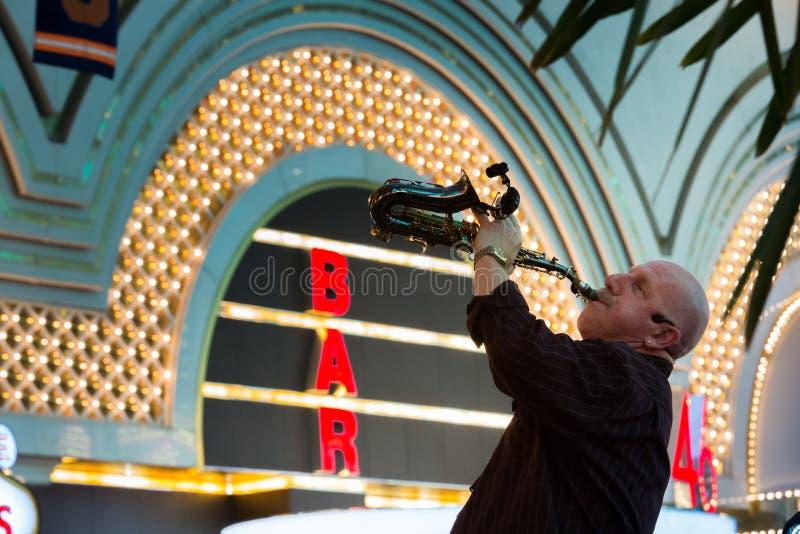 Saxophonist. Las Vegas, Freemont Street saxophonist earn money stock photography
