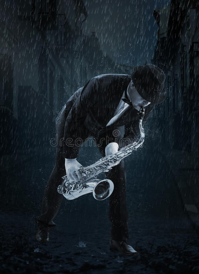 Saxophonist unter Regen stockfotos