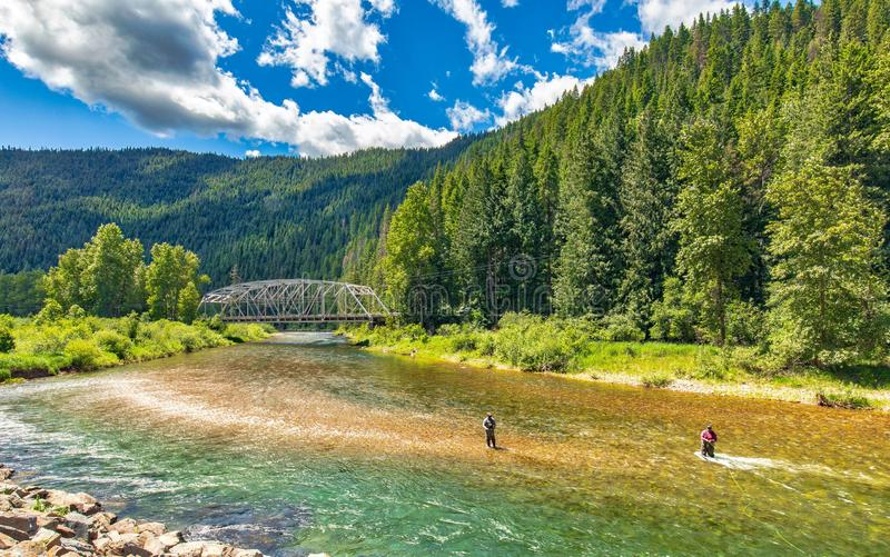 They say fly fishing is a art, watching these fisherman on the Coeur d`Alene river in Idaho was an art. The fish were biting and the weather was perfect for a royalty free stock image