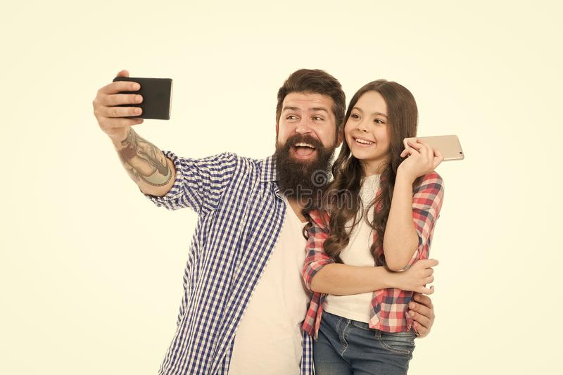 Say hello to family. Capture happy moments. Family selfie. Smartphone selfie. Dad and daughter having fun. Father and stock photography