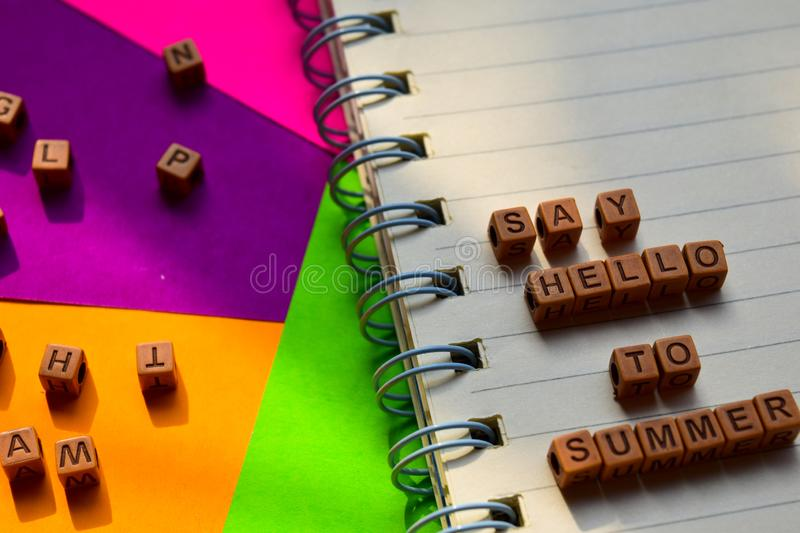 Say hello to summer message written on wooden blocks. Vacation and travel concepts. Cross processed image royalty free stock image