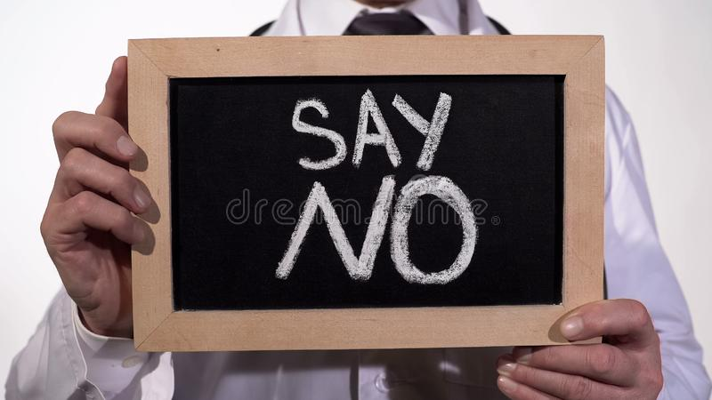 Say no text on blackboard in doctor hands, give up unhealthy lifestyle habits. Stock footage stock photo