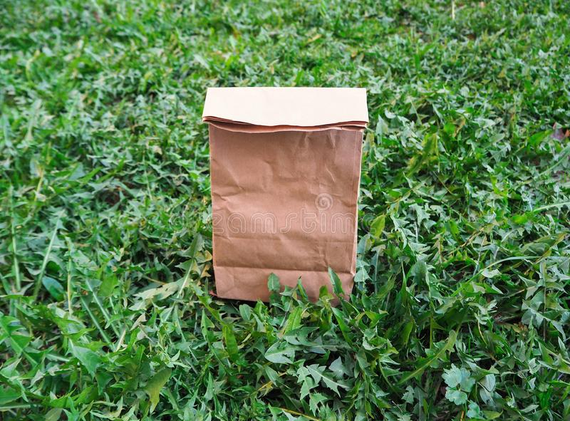 Say no to plastic bags ecological shopping bag on the green grass royalty free stock photos