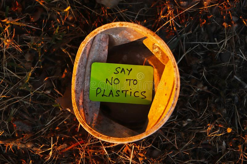 Say no to plastics. Say no to plastic written on a paper put in plastic cup in an open area. Environmental, pollution concept stock photos