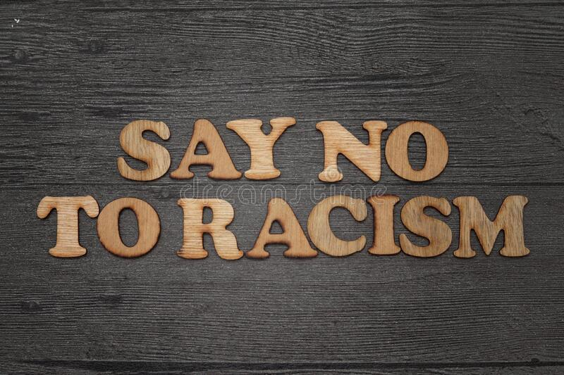 Say no to racism Racism, all men are created equal, wooden words text typograhy royalty free stock photography