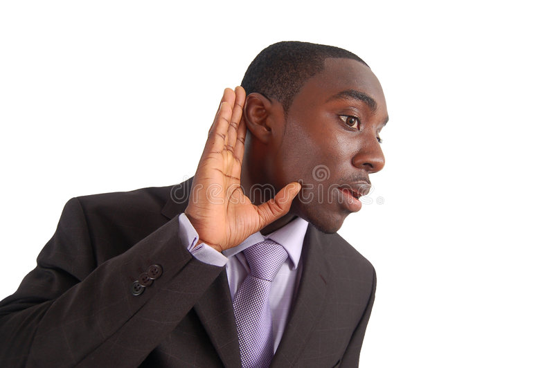 Say What?!. This is an image of a business man with his hand to his ear, as if to say Say what stock photography