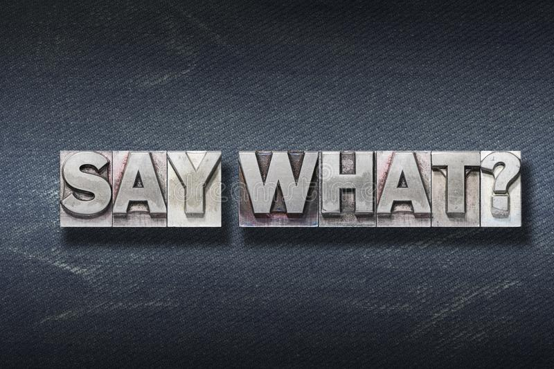 Say what den. Say what question made from metallic letterpress on dark jeans background royalty free stock images