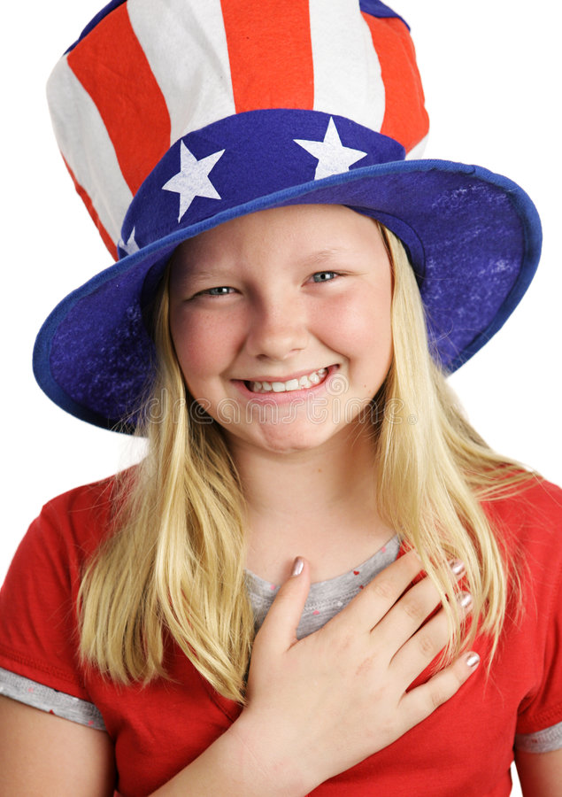 Saying The Pledge. A pretty American girl smiling and saying the Pledge of Allegiance. White background royalty free stock photos