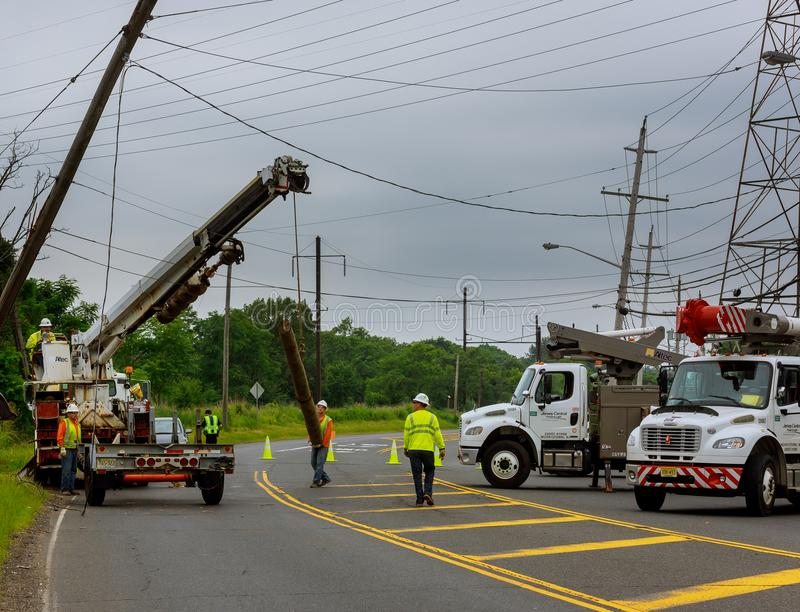 Sayreville NJ USA - Jujy 02, 2018: Construction work to replace the pillars of electrical wires. after car accident royalty free stock photography