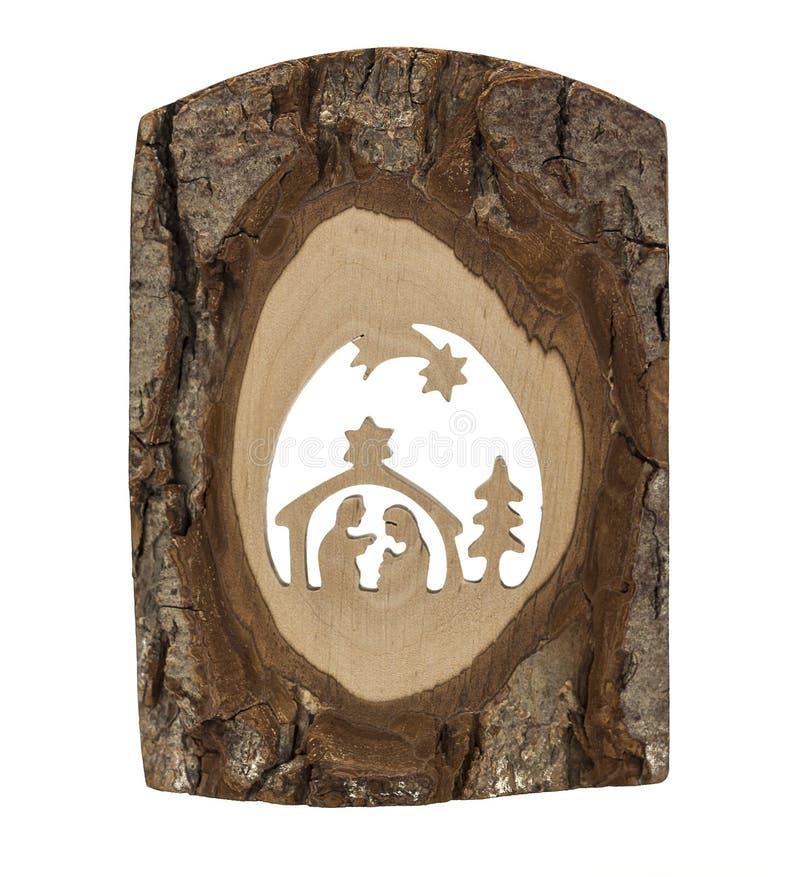 Scène de nativité découpée dans une écorce d'arbre photographie stock