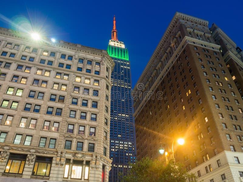 Scène de nuit avec l'Empire State Building à New York photos libres de droits