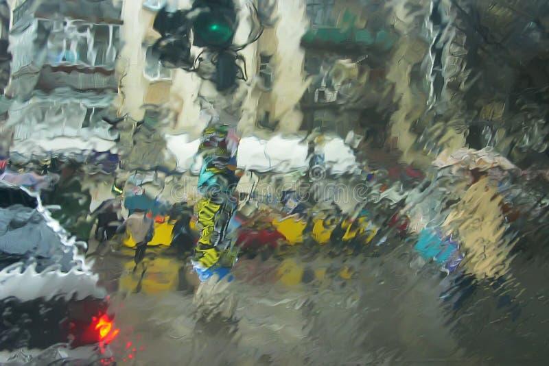 Scène urbaine par l'hublot humide photographie stock