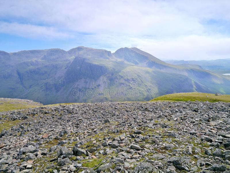 Scafells seen from Kirk Fell, Lake District. Sca Fell just right of centre with Scafell Pike to it`s left viewed from Kirk Fell stony summit area stock image