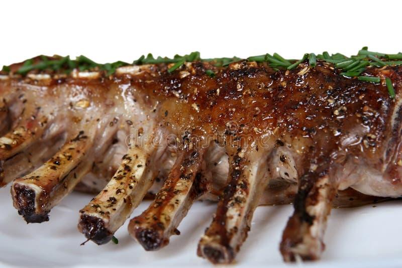 Scaffale del ristorante dell'alimento gastronomico del bbq delle costole di maiale fotografie stock