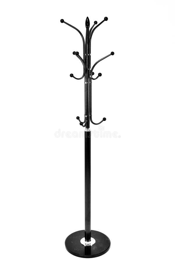 Scaffale metallico nero del cappotto, isolato su fondo bianco fotografia stock libera da diritti