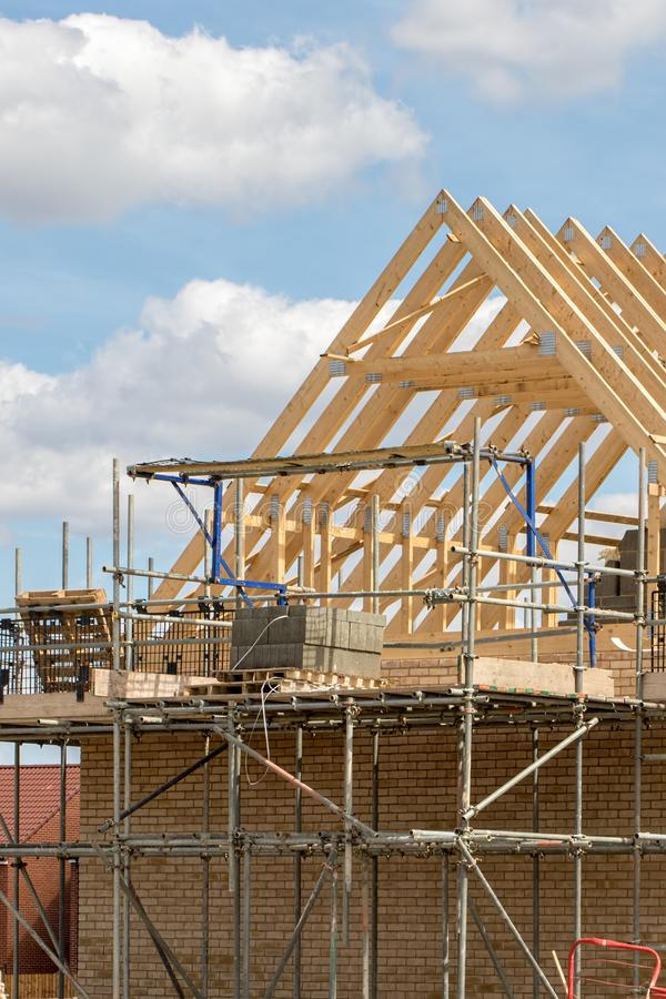 Scaffold platform and roof trusses on new building under construction royalty free stock photography