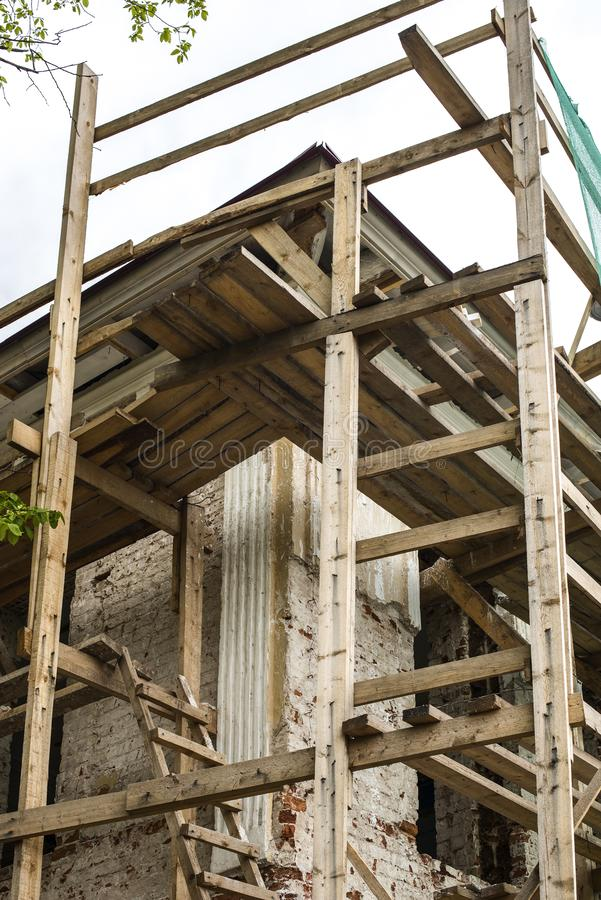 Wooden scaffolding around the ancient building stock photography