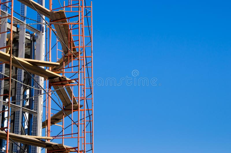 Scaffolding around the building under construction royalty free stock photo