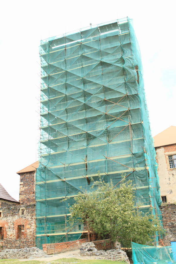 Scaffolding on castle tower royalty free stock images