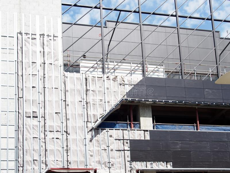 Scaffolding and Cladding on Mid-Rise Construction Site. Safety cladding on exterior scaffolding on a mid rise building construction site, Perth, Western stock photo