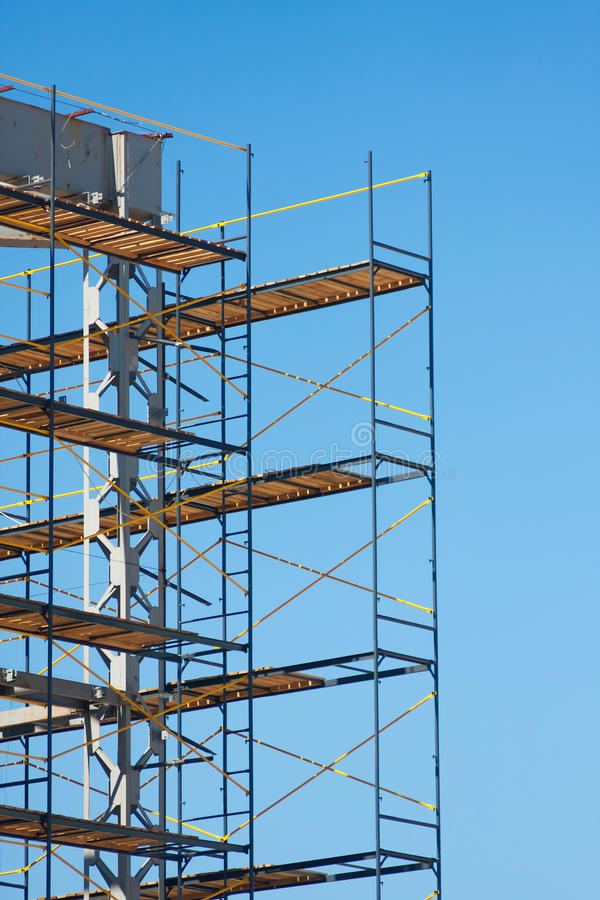 Scaffolding construction. With blue sky at background royalty free stock image