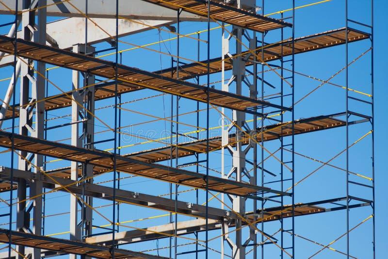 Scaffolding construction horizonal photo. Scaffolding construction with blue sky at background stock photos