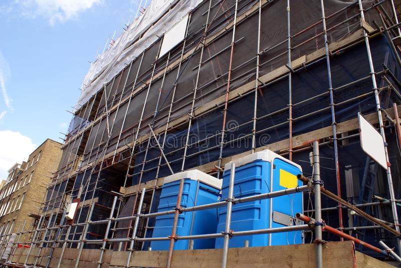 Scaffolding. construction site. portable toilets stock images
