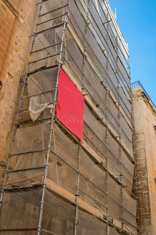 Scaffolding covered with white Canvas royalty free stock image