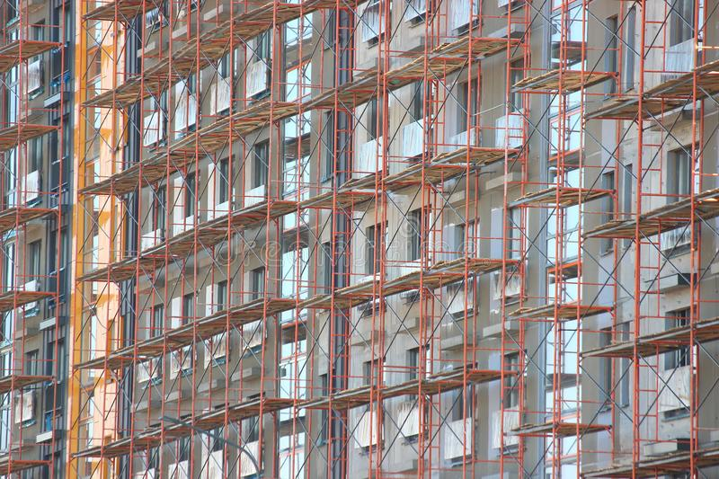 Scaffolding for exterior decoration of the house, modern construction of multi-storey and apartment buildings. concrete structures royalty free stock photography