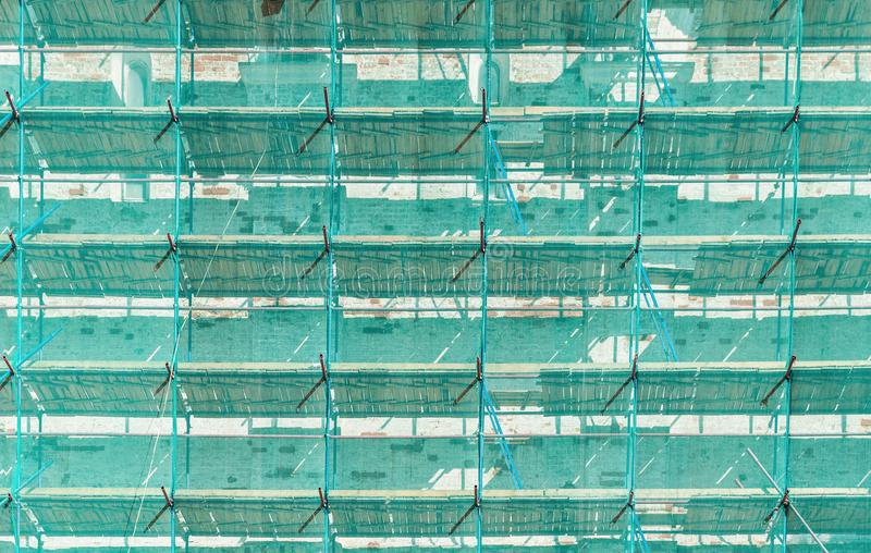 Scaffolding with green covering net royalty free stock images