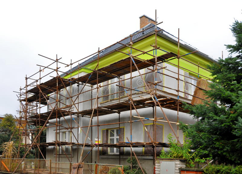 Scaffolding on the house stock photo