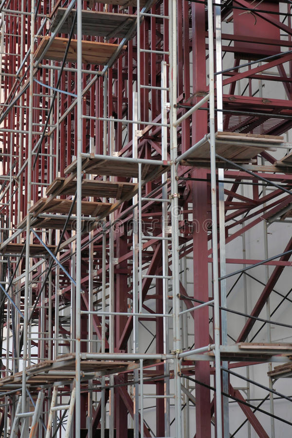 Scaffolding on multi-storey building. Repeating pattern of scaffolding on multi-storey building. Vertical format version royalty free stock photos
