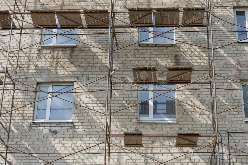 Scaffolding on the old 3 storey building. Bottom view stock photo